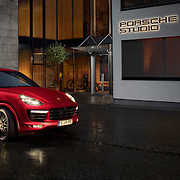 Porsche Macan car outside the Porsche Design Studio in Zell Am See Ray Massey is an established, award winning, UK professional  photographer, shooting creative advertising and editorial images from his stunning studio in a converted church in Camden Town, London NW1. Ray Massey specialises in drinks and liquids, still life and hands, product, gymnastics, special effects (sfx) and location photography. He is particularly known for dynamic high speed action shots of pours, bubbles, splashes and explosions in beers, champagnes, sodas, cocktails and beverages of all descriptions, as well as perfumes, paint, ink, water – even ice! Ray Massey works throughout the world with advertising agencies, designers, design groups, PR companies and directly with clients. He regularly manages the entire creative process, including post-production composition, manipulation and retouching, working with his team of retouchers to produce final images ready for publication.