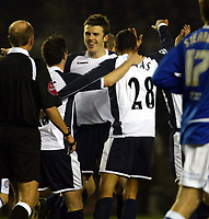 Photo: Chris Ratcliffe.<br /> Leicester City v Tottenham Hotspur. The FA Cup.<br /> 08/01/2006.<br /> Jermaine Jenas is mobbed by team mates Michael Carrick and Robbie Keane after opening the scoring