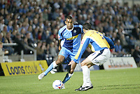 Photo: Marc Atkins.<br /> Wycombe Wanderers v Mansfield Town. Coca Cola League 2. 01/09/2006.  Kevin Betsy (L) goes past Gareth Jelleyman of Mansfield.