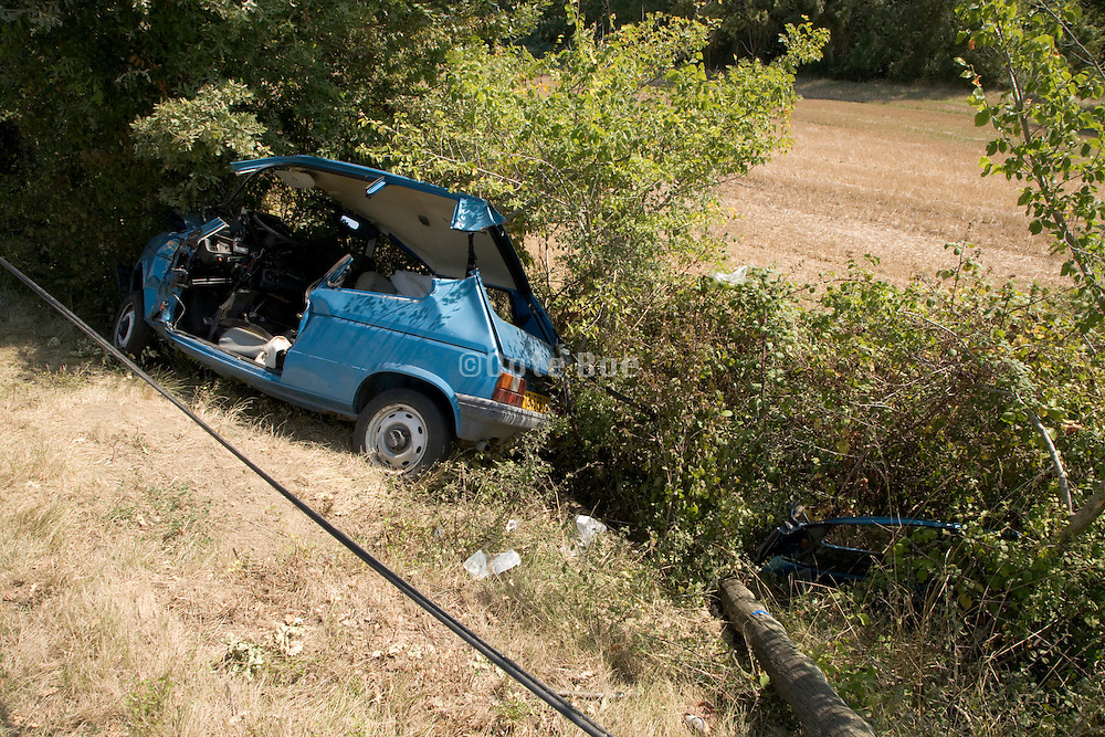 car which slipped of the road with roof cut open