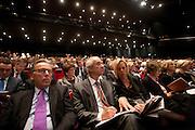 Minister Gerd Leers (tweede links) en senator Elco Brinkman tijdens het congres. In Utrecht houdt het CDA haar partijcongres. Het congres staat voor een groot deel in het teken van de uitzetting van Mauro. <br /> <br /> Minister Gerd Leers (2nd left) at the CDA congress in Utrecht. In his right hand side sits senator Elco Brinkman.