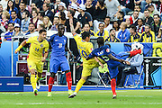 SAINT-DENIS, FRANCE, 10.06.2016 - FRANCE-ROMANIA - Dimitri Payet of France disputes the ball with Cristian Săpunaru of Romania, in a match valid for the 1st round of Group A of Euro 2016 in the Stade de France in Saint-Denis , on Friday (10)