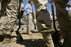 Paul Bremer, the U.S. overseer for Iraq, visits the site of the explosion while crews search for bodies at the Canal Hotel in Baghdad, Iraq on Aug. 21, 2003. Earlier in the week a cement truck packed with explosives detonated outside the offices of the UN headquarters in Baghdad, Iraq, killing 20 people and devastating the facility in an unprecedented suicide attack against the world body. At least 100 people were wounded.