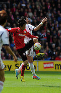 Cardiff city's Kim Bo-Kyung (l) battles for the ball with Bolton's  Chris Eagles. .NPower championship, Cardiff city v Bolton Wanderers at the Cardiff city Stadium in Cardiff, South Wales on Saturday 27th April 2013. pic by Andrew Orchard,  Andrew Orchard sports photography,