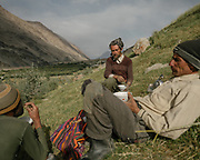In the field, a break of salty milk tea and flat bread. The traditional life of the Wakhi people, in the Wakhan corridor, amongst the Pamir mountains.