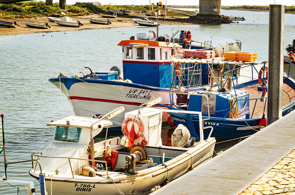 Colorfull Boats docked in the Gilão river, in Tavira, Porutgal.