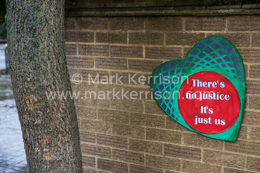 London, UK. 13 June, 2019. A Grenfell heart close to the Grenfell Tower in North Kensington. Tomorrow, the Grenfell community will mark the second anniversary of the Grenfell Tower fire on 14th June 2017 in which 72 people died and over 70 were injured. Two years on, some family members remain in temporary accommodation and many are still traumatised. Phase 2 of the Grenfell Inquiry will begin in 2020, with criminal investigation findings expected to be sent to the Crown Prosecution Service in 2021.