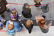 family waiting in line seen from above