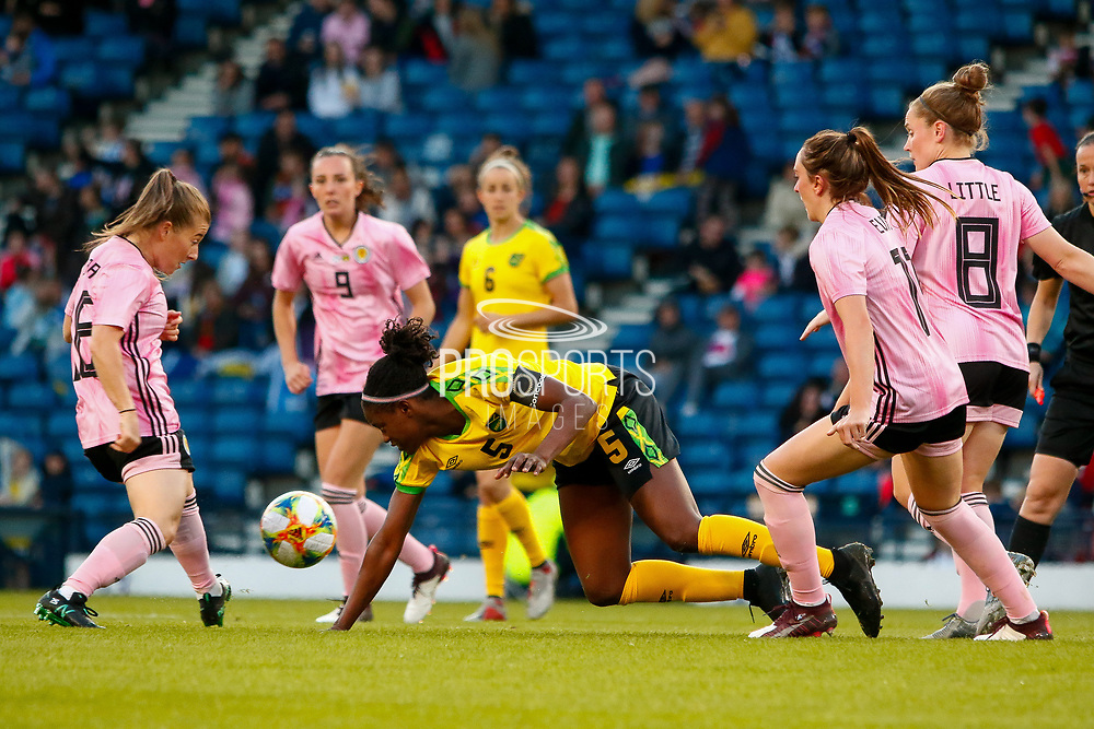 Jamaicas Konya PLUMMER (UCF Knights (USA)) gets brought down during the International Friendly match between Scotland Women and Jamaica Women at Hampden Park, Glasgow, United Kingdom on 28 May 2019.