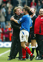Fotball<br /> FA-cup 2005<br /> Southampton v Portsmouth<br /> 29. januar 2005<br /> Foto: Digitalsport<br /> NORWAY ONLY<br /> Harry Redknapp still friends with the Portsmouth players if not the fans says bad luck to Arjan de Zeeuw, the Portsmouth captain