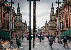 Shoppers on Buchanan Street in Glasgow reflected in shop window, Scotland, UK