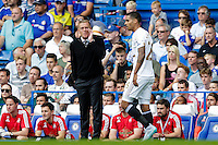 Swansea City manager Garry Monk shouts instructions to his team from the dug-out<br /> <br /> Photographer Craig Mercer/CameraSport<br /> <br /> Football - Barclays Premiership - Chelsea v Swansea City - Saturday 8th August 2015 - Stamford Bridge - London<br /> <br /> © CameraSport - 43 Linden Ave. Countesthorpe. Leicester. England. LE8 5PG - Tel: +44 (0) 116 277 4147 - admin@camerasport.com - www.camerasport.com