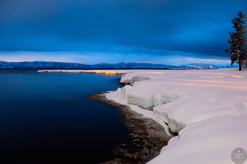"""""""Snowy Shore on Lake Tahoe 1"""" - This snowy shore line on Lake Tahoe was photographed at dusk in Tahoe City, CA."""