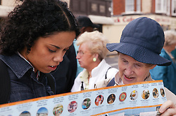 Two women looking at a map in the street,