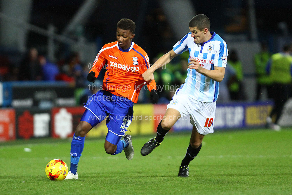 Demarai Gray of Birmingham City is held back by Conor Coady of Huddersfield Town. Skybet football league championship match, Huddersfield Town v Birmingham city at the John Smith's stadium in Huddersfield, Yorkshire on Saturday 20th December 2014.<br /> pic by Chris Stading, Andrew Orchard sports photography.