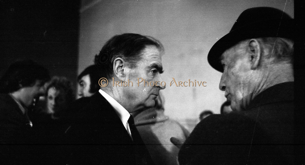 Mr Liam Cosgrave,Leader of Fine Gael,at Vote Count. (E48).1973..01.03.1971..03.01.1973..1st March 1973..As the ballot boxes were opened in Dun Laoghaire Town Hall, Mr Cosgrave and his supporters watched as the voting papers were piled high. The vote was as the result of an often hectic General Election campaign. Mr Cosgrave was hoping his party would garner enough votes to oust the sitting Fianna Fail Government which had held power for sixteen years...Picture of Mr Cosgrave as he receives word from a colleague as to how the vote is going.