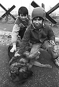 Boys with a stray dog in besieged Sarajevo. More than 12,000 people were killed by Serb forces and paramilitaries during the siege, part of the greater genocide in Bosnia.
