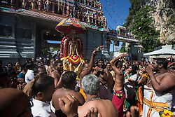 © Licensed to London News Pictures. 23/01/2016 Ipoh, Malaysia. Devotees carry the deity Lord Murugan into the Kallumalai Murugan Temple in Ipoh, Malaysia, during the Thaipusam Festival, Saturday, Jan. 23, 2016. Photo credit : Sang Tan/LNP