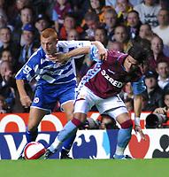 Photo: Dave Linney.<br />Aston Villa v Reading. The Barclays Premiership. 23/08/2006.Aston Villa's Juan Pablo Angel (R) keeps  Steve Sidwell at bay.