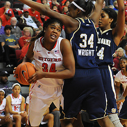 Rutgers Scarlet Knights forward/center Monique Oliver (34) looks for an open shot against Notre Dame Fighting Irish forward Markisha Wright (34) and forward Devereaux Peters (14) during second half NCAA Big East women's basketball action between Notre Dame and Rutgers at the Louis Brown Athletic Center. Notre Dame defeated Rutgers 71-41.