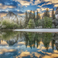 Sunrise on Half Dome and the Merced River after a spring snow storm.
