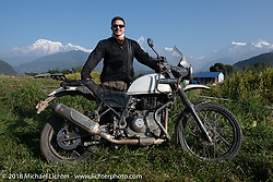 Chris Shelby poses with a spectacular background of 23,000' peaks on day-4 our our Himalayan Heroes adventure riding from Pokhara to Kalopani, Nepal. Friday, November 9, 2018. Photography ©2018 Michael Lichter.