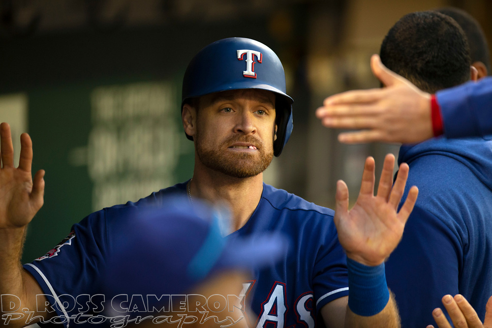 Jul 25, 2019; Oakland, CA, USA; Texas Rangers Logan Forsythe (41) gets high fives from his teammates after scoring during the fifth inning of a baseball game against the Oakland Athletics at Oakland Coliseum. Mandatory Credit: D. Ross Cameron-USA TODAY Sports