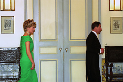 The Prince and Princess of Wales keep their distance as they attend a banquet at the Portuguese embassy in London.
