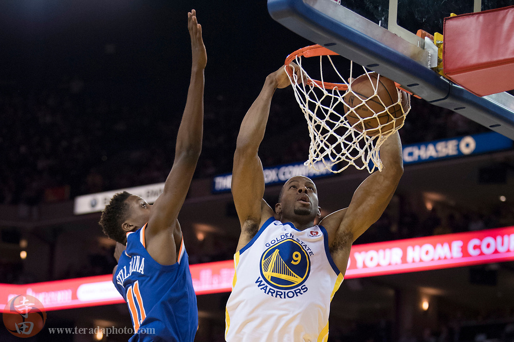 January 23, 2018; Oakland, CA, USA; Golden State Warriors forward Andre Iguodala (9) dunks the basketball against New York Knicks guard Frank Ntilikina (11) during the fourth quarter at Oracle Arena. The Warriors defeated the Knicks 123-112.
