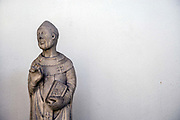 Detail of a sculpture in the Museum of Saint Agostina, Genoa, Italy. Begun by the Augustinians in 1260, it is one of the few Gothic buildings remaining in the city, after the numerous demolitions in the 19th century. Secularised in the 1790s it eventually became a museum of architecture before being destroyed in the Second World War. The building reopened as the Museo di SantAgostino in 1984.