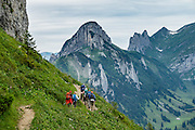 Hiking on Hoher Kasten mountain in the Alpstein limestone range, Appenzell Alps, Switzerland, Europe. Hoher Kasten (1795 m) is on the border between the cantons of Appenzell Innerrhoden and St. Gallen. Appenzell Innerrhoden is Switzerland's most traditional and smallest-population canton (second smallest by area).