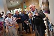 Henry Wilhelm '68 gives a guided tour of the 1966 Yearbook Project exhibit in Faulconer Gallery during Alumni Reunion 2012.