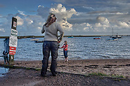 Series: By The Sea - Orford - photo art pictures of tourists by the river Alde in the mud by Paul Williams. 2007