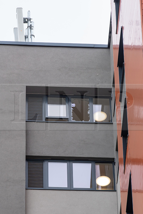 © Licensed to London News Pictures. 25/09/2019. Headington, UK. A broken window on a top floor apartment at Foresters Tower. Thames Valley Police were called to Foresters Tower in Wood Farm Road, Headington, at 21:18 BST on 24th September 2019 to reports that a man had fallen from an upper floor of Foresters Tower. The man died at the scene. <br /> Following a search of flats at Foresters Tower, a woman was located on the fourth floor with severe neck injuries and was pronounced dead at the scene.. Photo credit: Peter Manning/LNP