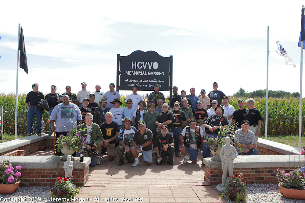 Vietnam Veterans of the 25th Infantry Division - Tropic Lightning - pose for a group photo during the Vietnam Veterans gathering in Kokomo, Indiana for the 2009 reunion.
