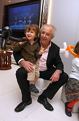 News journalist JEREMY BOWEN and his son BOATIE (Jack) BOWEN at the English National Ballet's Mad Hatters Tea Party at St.Martins Lane Hotel, St Martins Lane, London on 12th December 2006.<br /><br />NON EXCLUSIVE - WORLD RIGHTS