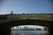 Banners were dropped on bridges crossing the Thames in protest against the inauguration of Donald Trump, January 21st 2017 in London. A Queer Solidarity banner on Vauxhall Bridge. On Friday 20th January over 50 groups across the United Kingdom dropped banners from bridges as an act of defiance against Trump's inauguration. The groups, who form the 'Bridges not Walls' movement, staged their demonstration to show support for people in the USA and beyond fearing the consequences of Trump's election. <br /> <br /> In London ten iconic bridges on the Thames saw huge banners 25m long unfurled on them.