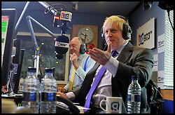 The London Mayor Boris Johnson during a Live debate on LBC Radio with the other Mayoral candidates Ken Livingstone (to Boris's right), Brian Paddick (lib dems) and Jenny Jones (Green Party), London, UK,Tuesday April 3, 2012. Photo By Andrew Parsons / i-Images.