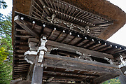 """Myozenji Buddhist Temple in Hida Shirakawa-go. Ogimachi is the largest village and main attraction of the Shirakawa-go region, in Ono District, Gifu Prefecture, Japan. Declared a UNESCO World Heritage Site in 1995, Ogimachi village hosts several dozen well preserved gassho-zukuri farmhouses, some more than 250 years old. Their thick roofs, made without nails, are designed withstand harsh, snowy winters and to protect a large attic space that was formerly used to cultivate silkworms. Many of the farmhouses are now restaurants, museums or minshuku lodging. Some farmhouses from surrounding villages have been relocated to the peaceful Gassho-zukuri Minka-en Outdoor Museum, across the river from the town center. Gassho-zukuri means """"constructed like hands in prayer"""", as the farmhouses' steep thatched roofs resemble the hands of Buddhist monks pressed together in prayer."""