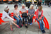 Group of ladies on a day out in London sit together on one of the flourescent benches on the Southbank, London, United Kingdom. The South Bank is a significant arts and entertainment district, and home to an endless list of activities for Londoners, visitors and tourists alike. (photo by Mike Kemp/In Pictures via Getty Images)