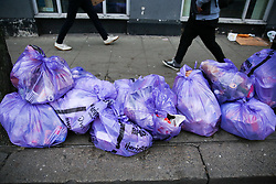 © Licensed to London News Pictures. 01/01/2020. London, UK. Rubbish piles up on Green Lanes in north London with Christmas and New Year Eve celebrations waste. UK creates 30 per cent more waste over the festive period than usual. Photo credit: Dinendra Haria/LNP
