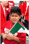 Cinco de Mayo parade participant age 11 Mexican Flag.  St Paul Minnesota USA