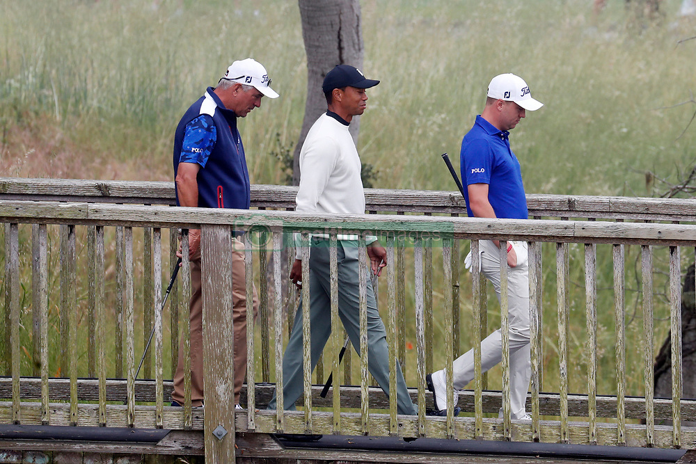 June 12, 2019 - Pebble Beach, CA, U.S. - PEBBLE BEACH, CA - JUNE 12: From left to right PGA golfers Tiger Woods and Justin Thomas walk the 16th hole during a practice round for the 2019 US Open on June 12, 2019, at Pebble Beach Golf Links in Pebble Beach, CA. (Photo by Brian Spurlock/Icon Sportswire) (Credit Image: © Brian Spurlock/Icon SMI via ZUMA Press)
