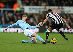 27 December 2017 Newcastle: Premier League Football - Newcastle United v Manchester City : Kevin De Bruyne of Man City slides to win the ball in a tackle with Jacob Murphy of Newcastle.<br /> (photo by Mark Leech)