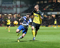 Reading's Adam Le Fondre is challenged by Watford's Joel Ekstrand - Photo mandatory by-line: Nigel Pitts-Drake/JMP - Tel: Mobile: 07966 386802 11/01/2014 - SPORT - FOOTBALL - Vicarage Road - Watford - Watford v Reading - Sky Bet Championship
