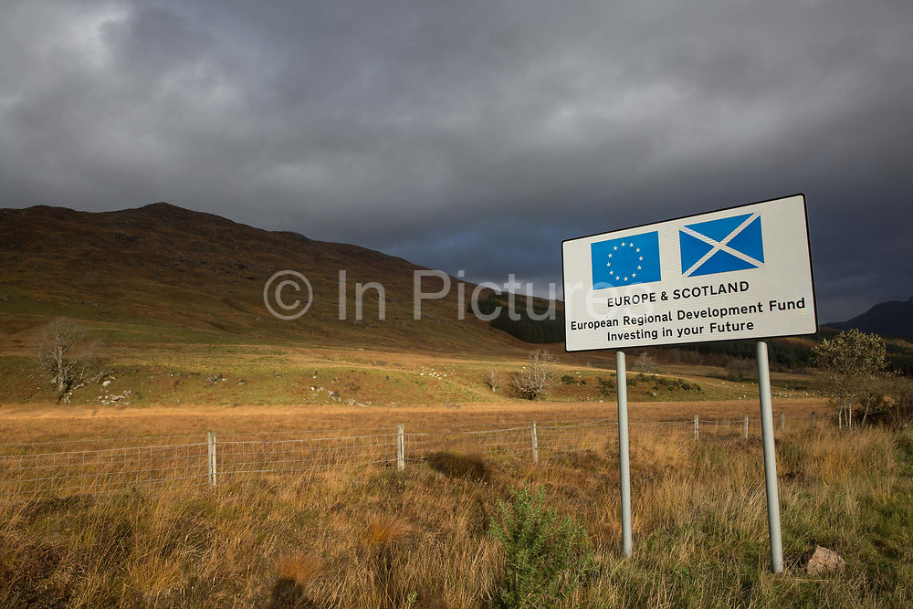 A road sign in Wester Ross promoting the European Regional Development Fund on the 4th November 2018 on the west coast of Scotland in the United Kingdom. The development fund is a partnership with the European Union and Scotland to invest in the Scottish future.