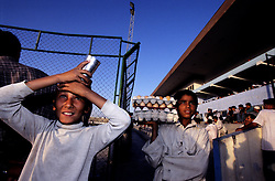 Young men sell boiled eggs and fresh water to the people at Ghazi Stadium