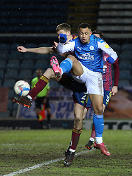Jonson Clarke-Harris of Peterborough United challenges for the ball against Ipswich Town - Mandatory by-line: Joe Dent/JMP - 09/02/2021 - FOOTBALL - Weston Homes Stadium - Peterborough, England - Peterborough United v Ipswich Town - Sky Bet League One
