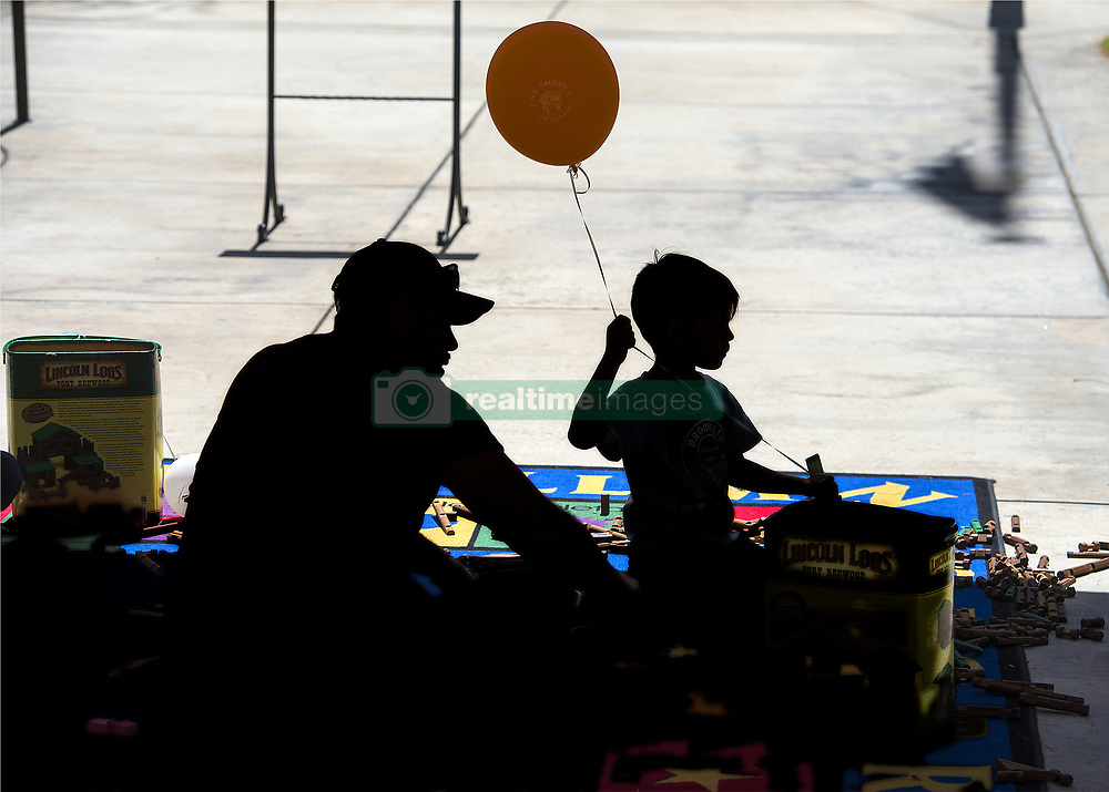 May 5, 2019 - Redlands, California, U.S. - Lincoln Logs are played with under a tarp near The Lincoln Memorial Shrine, a museum and research facility dedicated to Abraham Lincoln and the Civil War. The 8th annual Library Day was held at A.K. Smiley Public Library in Redlands, Calif. on Saturday, May 4, 2019. (Credit Image: © Cindy Yamanaka/SCNG via ZUMA Wire)