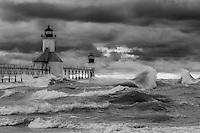 High winds on the lake shore in Saint Joseph whip the waters of Lake Michigan into a powerful display of crashing waves